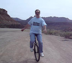Unicyclist displays ChatterBlocker t-shirt